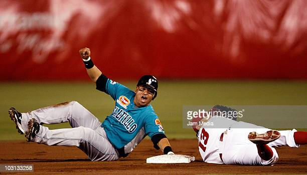 Hernando Arredondo of the Saraperos de Saltillo and Oscar Robles of Diablos Rojos de Mexico in action during the 2010 Mexican Baseball League...