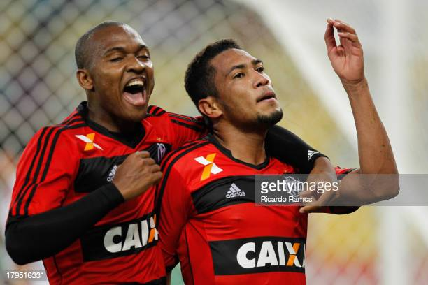 Hernane of Flamengo celebrates after scoring with his teammate Samir during a match between Flamengo and Vitoria as part of Brazilian Serie A 2013 at...