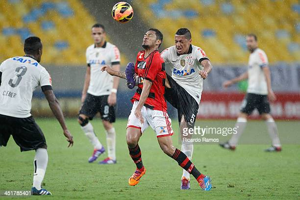 Hernane of Flamengo fights for the ball with Ralf of Corinthoians during the match between Flamengo and Corinthians for the Brazilian Series A 2013...