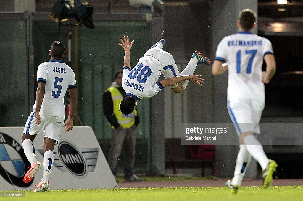 <a gi-track='captionPersonalityLinkClicked' href=/galleries/search?phrase=Hernanes&family=editorial&specificpeople=4522139 ng-click='$event.stopPropagation()'>Hernanes</a> (C) of FC Internazionale Milano celebrates after scoring a goal during the Serie A match between AS Livorno Calcio and FC Internazionale Milano at Stadio Armando Picchi on March 31, 2014 in Livorno, Italy.