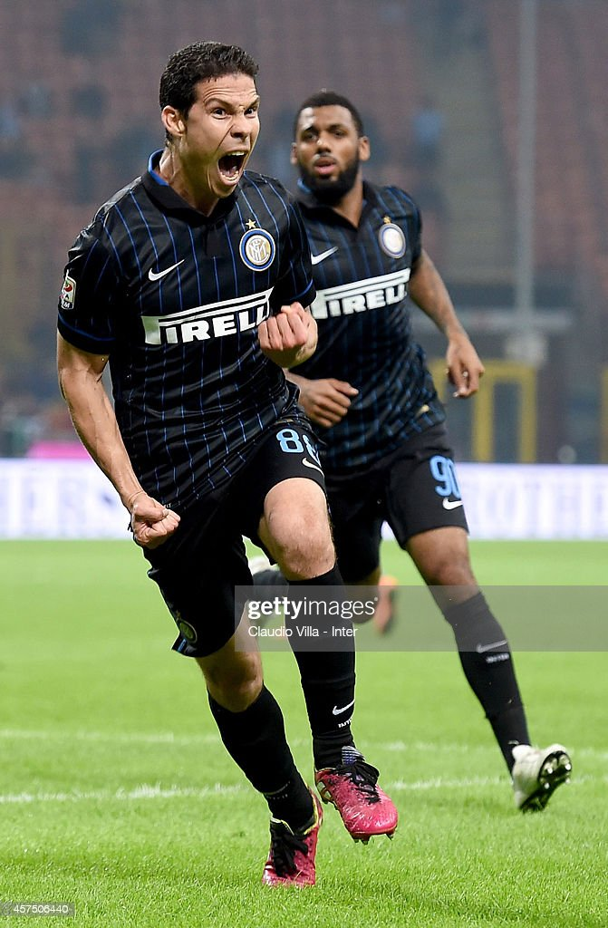 <a gi-track='captionPersonalityLinkClicked' href=/galleries/search?phrase=Hernanes&family=editorial&specificpeople=4522139 ng-click='$event.stopPropagation()'>Hernanes</a> of FC Internazionale Milano #88 celebrates after scoring the second goal during the Serie A match between FC Internazionale Milano and SSC Napoli at Stadio Giuseppe Meazza on October 19, 2014 in Milan, Italy.