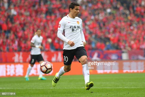 Hernanes of Hebei China Fortune drives the ball during the 2nd round match of CSL Chinese Football Association between Chongqing Lifan and Hebei...