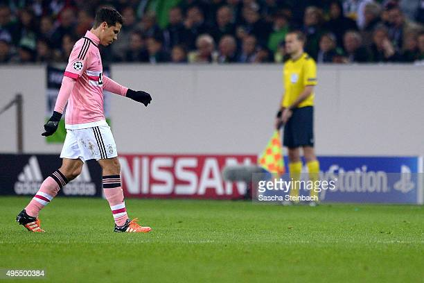 Hernanes of Juventus leaves the pitch after been sent off and booked red card during the UEFA Champions League group stage match between VfL Borussia...