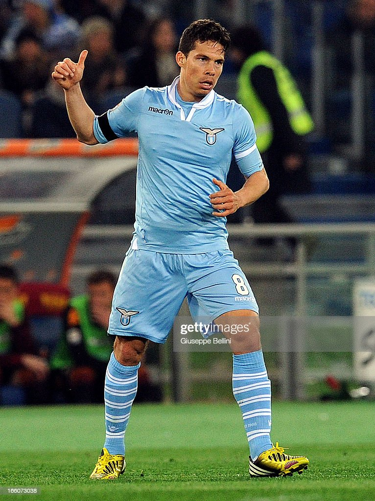 Hernanes of Lazio celebrates after scoring the opening goal during the Serie A match between AS Roma and S.S. Lazio at Stadio Olimpico on April 8, 2013 in Rome, Italy.
