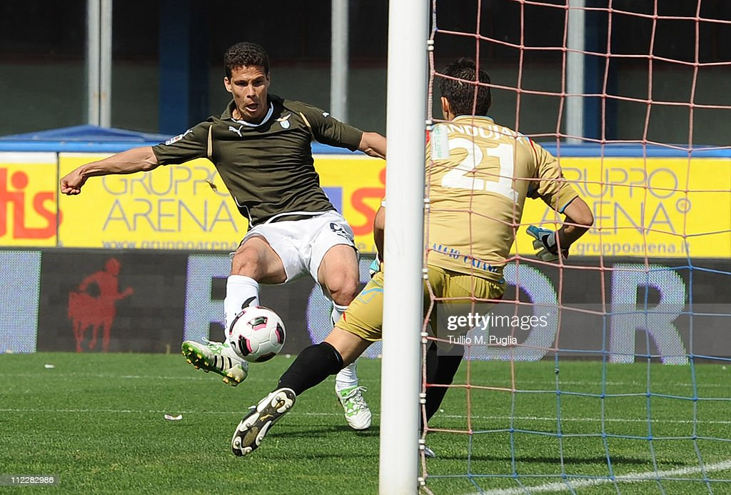 <a gi-track='captionPersonalityLinkClicked' href=/galleries/search?phrase=Hernanes&family=editorial&specificpeople=4522139 ng-click='$event.stopPropagation()'>Hernanes</a> of Lazio scores the opening goal past goalkeeper <a gi-track='captionPersonalityLinkClicked' href=/galleries/search?phrase=Mariano+Andujar&family=editorial&specificpeople=804546 ng-click='$event.stopPropagation()'>Mariano Andujar</a> of Catania Calcio during the Serie A match between Catania Calcio and SS Lazio at Stadio Angelo Massimino on April 17, 2011 in Catania, Italy.