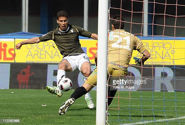 Hernanes of Lazio scores the opening goal past goalkeeper Mariano Andujar of Catania Calcio during the Serie A match between Catania Calcio and SS...