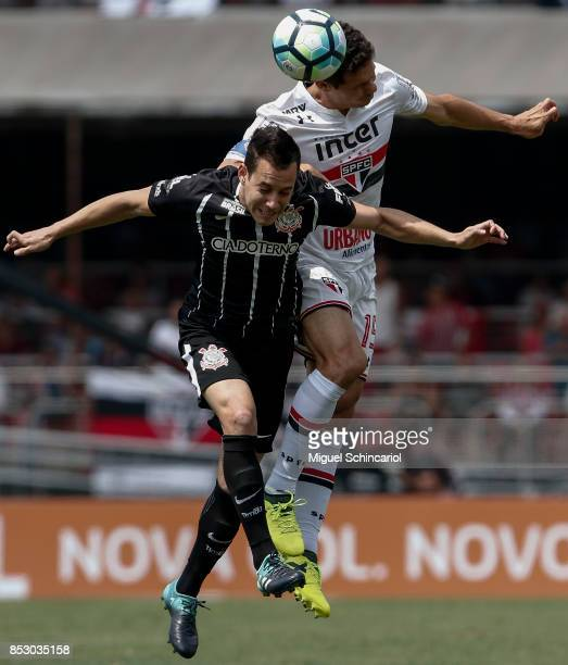 Hernanes of Sao Paulo vies the ball with Rodriguinho of Corinthians during the match between Sao Paulo and Corinthians for the Brasileirao Series A...