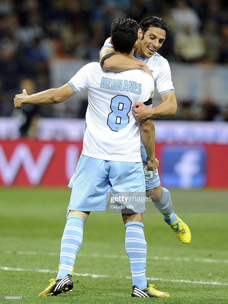 <a gi-track='captionPersonalityLinkClicked' href=/galleries/search?phrase=Hernanes&family=editorial&specificpeople=4522139 ng-click='$event.stopPropagation()'>Hernanes</a> of S.S. Lazio #8 celebrates his goal with team-mate <a gi-track='captionPersonalityLinkClicked' href=/galleries/search?phrase=Sergio+Floccari&family=editorial&specificpeople=675401 ng-click='$event.stopPropagation()'>Sergio Floccari</a> during the Serie A match between FC Internazionale Milano and S.S. Lazio at San Siro Stadium on May 8, 2013 in Milan, Italy.