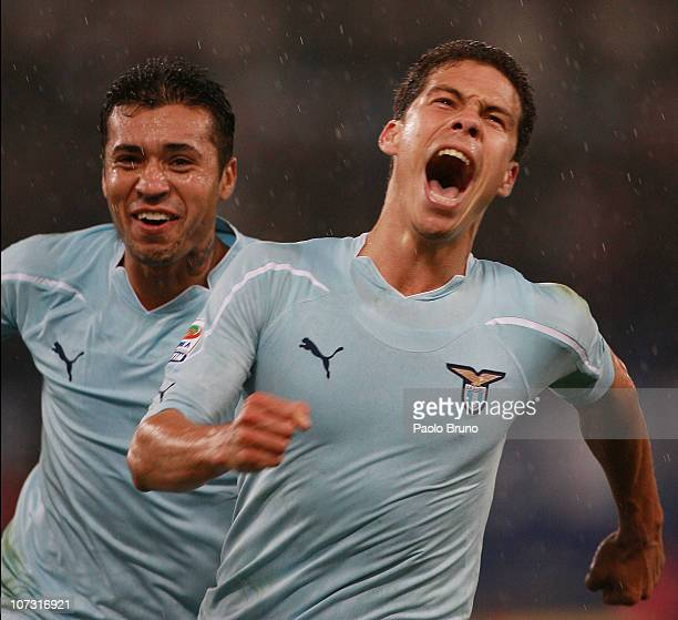 Hernanes of SS Lazio celebrates with Francelino Matuzalem after scoring the third goal during the Serie A match between SS Lazio and FC...
