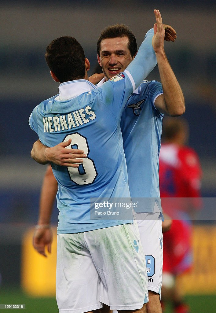 Hernanes (L) of SS Lazio celebrates with team-mate Senad Lulic after scoring their team's third goal during the TIM Cup match between S.S. Lazio and Calcio Catania at Stadio Olimpico on January 8, 2013 in Rome, Italy.