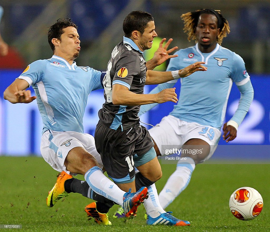 <a gi-track='captionPersonalityLinkClicked' href=/galleries/search?phrase=Hernanes&family=editorial&specificpeople=4522139 ng-click='$event.stopPropagation()'>Hernanes</a> (L) of SS Lazio competes for the ball with <a gi-track='captionPersonalityLinkClicked' href=/galleries/search?phrase=Camel+Meriem&family=editorial&specificpeople=697194 ng-click='$event.stopPropagation()'>Camel Meriem</a> of Apollon Limassol FCduring the UEFA Europa League Group J match between SS Lazio and Apollon Limassol FC at Stadio Olimpico on November 7, 2013 in Rome, Italy.
