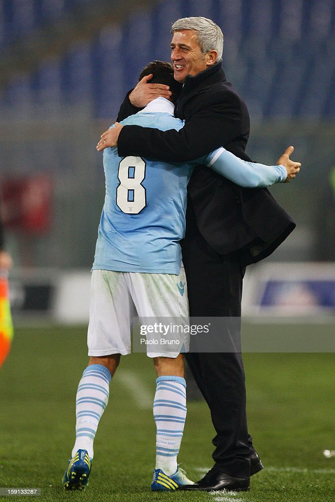 Hernanes (L) of SS Lazio is congratulated by head coach Vladimir Petkovic after scoring their team's third goal during the TIM Cup match between S.S. Lazio and Calcio Catania at Stadio Olimpico on January 8, 2013 in Rome, Italy.