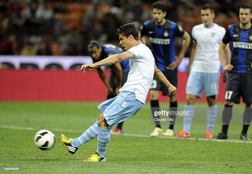 <a gi-track='captionPersonalityLinkClicked' href=/galleries/search?phrase=Hernanes&family=editorial&specificpeople=4522139 ng-click='$event.stopPropagation()'>Hernanes</a> of S.S. Lazio scores the second goal from the penalty spot during the Serie A match between FC Internazionale Milano and S.S. Lazio at San Siro Stadium on May 8, 2013 in Milan, Italy.