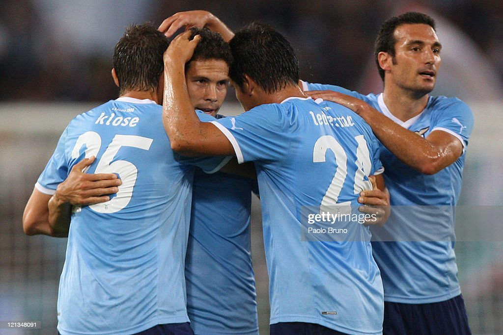 <a gi-track='captionPersonalityLinkClicked' href=/galleries/search?phrase=Hernanes&family=editorial&specificpeople=4522139 ng-click='$event.stopPropagation()'>Hernanes</a> (2nd L) with his teammates of SS Lazio celebrates after scoring the opening goal during the UEFA Europa League playoff first leg match between S.S. Lazio and FK Rabotnicki at Olimpico stadium on August 18, 2011 in Rome, Italy.