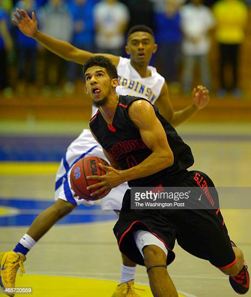 Herndon's Dorian Johnson blows past Robinson's Ashrifi NaiTetteh for a 1st half score as Robinson defeats Herndon 82 67 in boys basketball at...