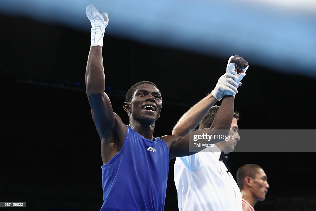Herney Yurberjen Martinez of Colombia celebrates against Rogen Ladon of the Phillipines in their Mens 4649 Light Fly Weight bout on Day 3 of the Rio...