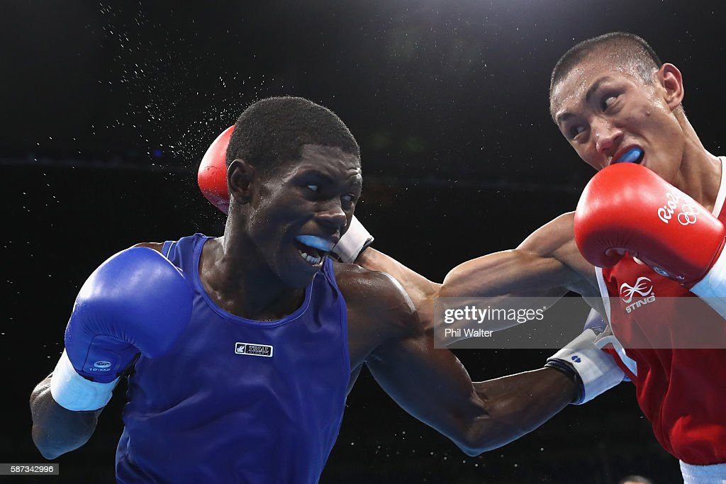 Herney Yurberjen Martinez of Colombia fights Rogen Ladon of the Phillipines in their Mens 4649 Light Fly Weight bout on Day 3 of the Rio 2016 Olympic...