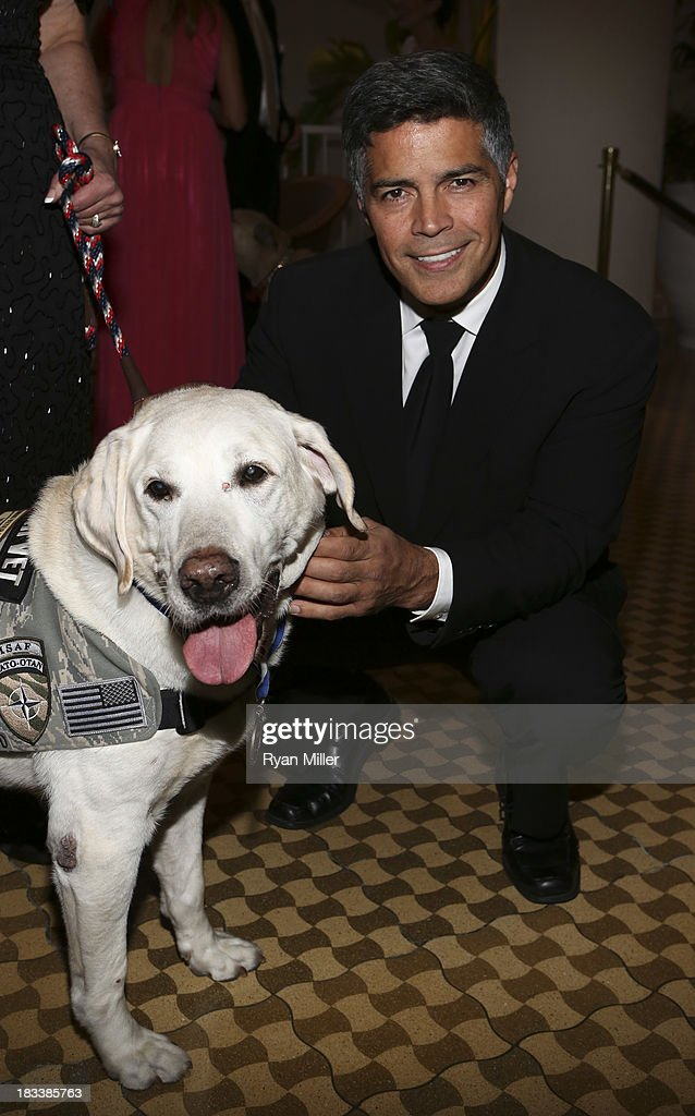 Hero Dog CWD Carlos EDD (L) and actor <a gi-track='captionPersonalityLinkClicked' href=/galleries/search?phrase=Esai+Morales&family=editorial&specificpeople=208672 ng-click='$event.stopPropagation()'>Esai Morales</a> (R) pose during the American Humane Association Hero Dog Awards 2013 held at the Beverly Hilton Hotel on Saturday, Oct. 5, 2013, in Beverly Hills, California.