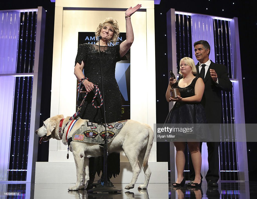 Hero Dog CWD Carlos EDD, owner Ruby Ridpath, actress <a gi-track='captionPersonalityLinkClicked' href=/galleries/search?phrase=Lauren+Potter&family=editorial&specificpeople=7243163 ng-click='$event.stopPropagation()'>Lauren Potter</a> and actor <a gi-track='captionPersonalityLinkClicked' href=/galleries/search?phrase=Esai+Morales&family=editorial&specificpeople=208672 ng-click='$event.stopPropagation()'>Esai Morales</a> present during the American Humane Association Hero Dog Awards 2013 held at the Beverly Hilton Hotel on Saturday, Oct. 5, 2013, in Beverly Hills, California.