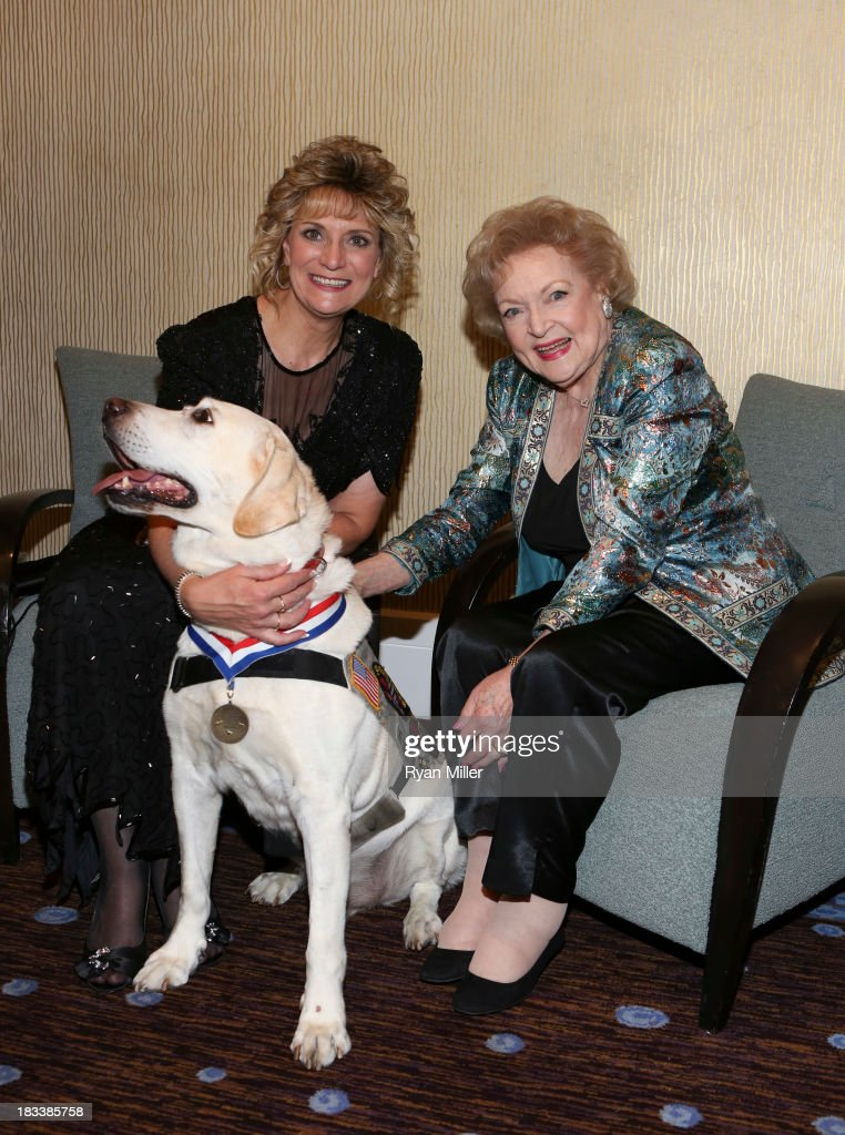 Hero Dog CWD Carlos EDD, owner Ruby Ridpath and actress <a gi-track='captionPersonalityLinkClicked' href=/galleries/search?phrase=Betty+White&family=editorial&specificpeople=213602 ng-click='$event.stopPropagation()'>Betty White</a> pose during the American Humane Association Hero Dog Awards 2013 held at the Beverly Hilton Hotel on Saturday, Oct. 5, 2013, in Beverly Hills, California.
