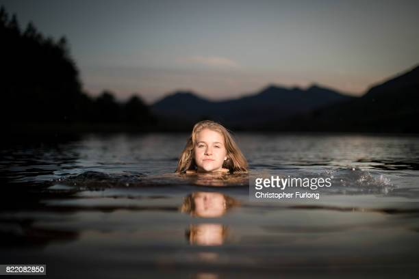 Hero Douglas poses as she swims in Llyn Mymbyr in the shadow of Snowdon and Snowdonia in North Wales on July 24 2017 in Capel Curig United Kingdom...