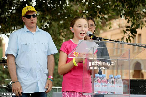 Hero Samantha Hill speaks on stage with Alex's Lemonade Stand Foundation CoExecutive Directors Liz Scott and Jay Scott by her side during LA Loves...