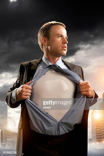 heroic businessman opening shirt