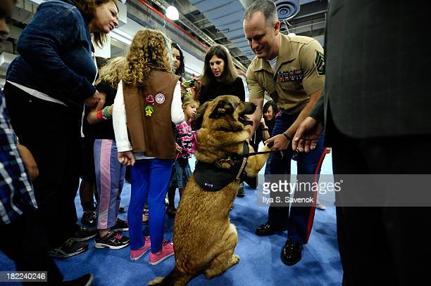 Heroic Military Dog Award winner Lucca and handler Gunnery Sgt Chris Willingham attend Day 1 of AKC 'Meet The Breeds' showcase at Jacob Javits Center...
