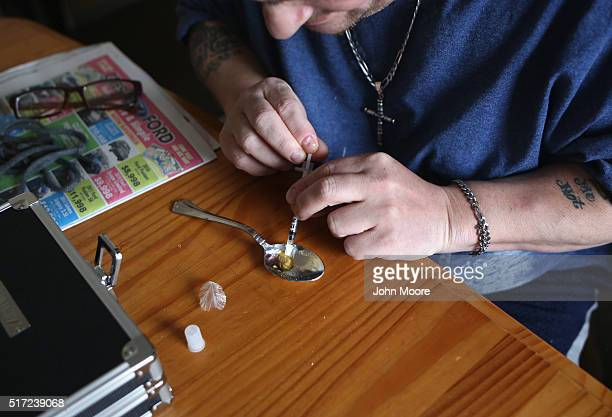 A heroin user prepares to inject himself on March 23 2016 in New London CT Communities nationwide are struggling with the unprecidented heroin and...