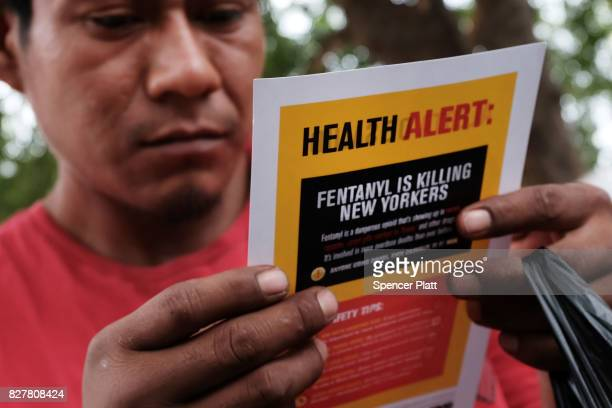 A heroin user reads an alert on fentanyl before being interviewed by John Jay College of Criminal Justice students as part of a project to interview...