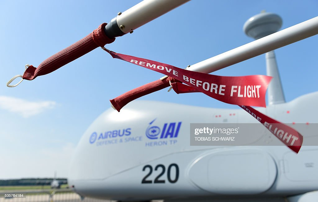 A 'Heron' drone is seen at the International Aerospace Exhibition (ILA) in Schoenefeld near Berlin on May 30, 2016. The Aerospace Exhibition at Schoenefeld Airport takes place from June 1 to 4, 2016. / AFP / TOBIAS