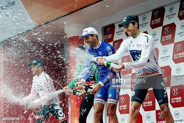 Herrada Lopez Jesus of Movistar team Mangel Laurent Gilbert Philippe and Van Der Sande Tosh spray champagne on the podium after the second stage of...
