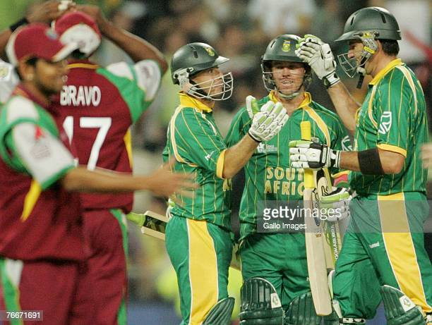 Herschelle Gibbs AB de Villiers and Justin Kemp of South Africa celebrate their victory during the ICC Twenty20 Cricket World Cup match between South...