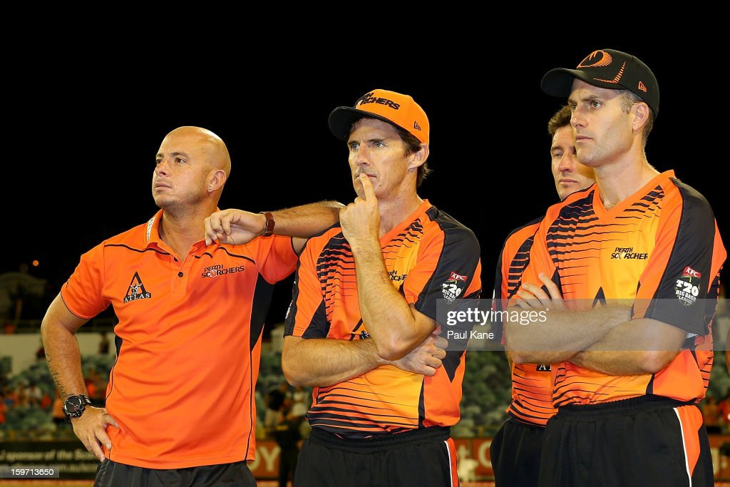 Herschelle Gibbs, Brad Hogg and Simon Katich of the Scorchers look on after being defeated during the Big Bash League final match between the Perth Scorchers and the Brisbane Heat at the WACA on January 19, 2013 in Perth, Australia.