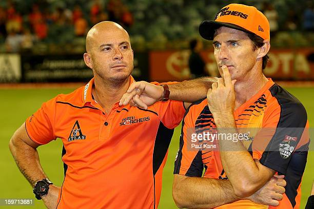Herschelle Gibbs Brad Hogg of the Scorchers look on after being defeated during the Big Bash League final match between the Perth Scorchers and the...