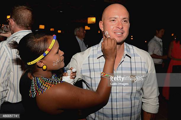 Herschelle Gibbs has his face painted during the official welcome function ahead of the Gary Player Invitational presented by CocaCola at The Palace...