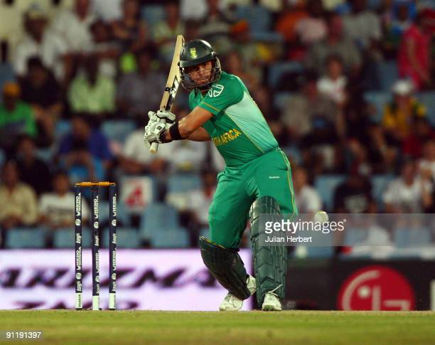 Herschelle Gibbs of South Africa hits a 6 of the bowling of Graham Onions during The ICC Champions Trophy match between South Africa and England...