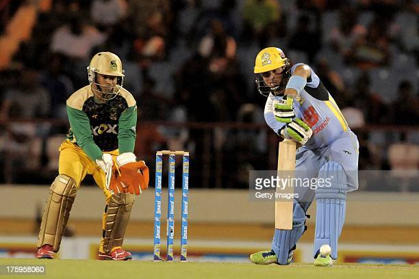 Herschelle Gibbs of St Lucia Zouks defends a delivery from Jamaica Tallawahs Nikita Miller during the Twelfth Match of the Caribbean Premier League...