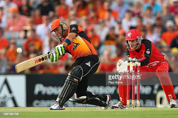 Herschelle Gibbs of the Scorchers hits a boundary during the Big Bash League match between the Perth Scorchers and the Melbourne Renegades at WACA on...