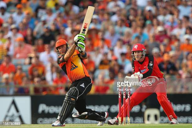 Herschelle Gibbs of the Scorchers hits a six during the Big Bash League match between the Perth Scorchers and the Melbourne Renegads at WACA on...