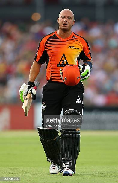 Herschelle Gibbs of the Scorchers walks from the field after being dismissed for 56 during the Big Bash League match between the Perth Scorchers and...