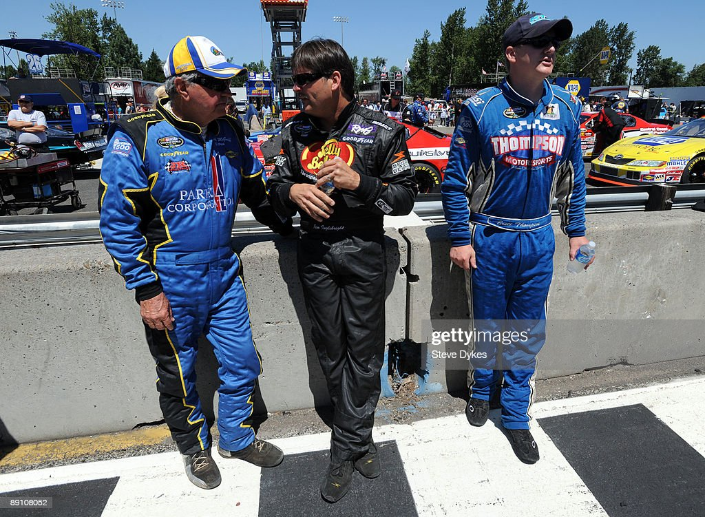 Hershel McGriff, Jim Inglebright and <a gi-track='captionPersonalityLinkClicked' href=/galleries/search?phrase=Brett+Thompson+-+Race+Car+Driver&family=editorial&specificpeople=15162131 ng-click='$event.stopPropagation()'>Brett Thompson</a> await the start of the NASCAR Camping World Series West BI-MART Salute to the Troops 125 at Portland International Raceway on July 19, 2009 in Portland, Oregon. Inglebright won the race with Thompson finishing fourth and McGriff placing 13th.(Photo by Steve Dykes/Getty Images for NASCAR) nascarmms