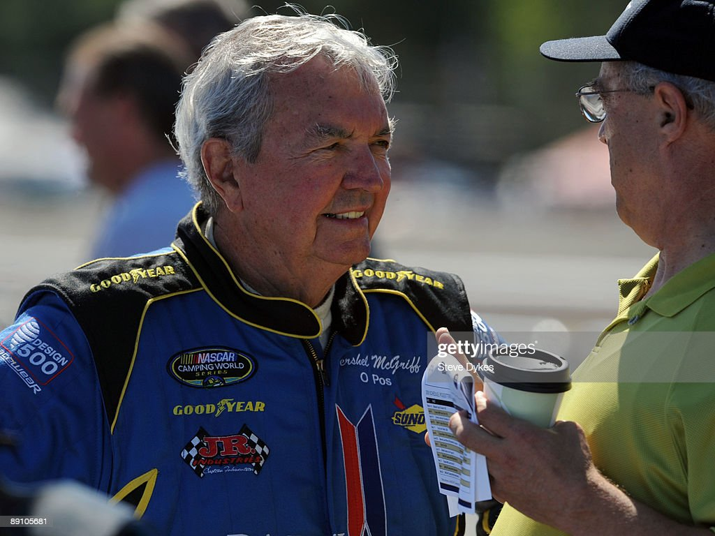Hershel McGriff (L) speaks with fans in the pit area before qualifying for the NASCAR Camping World Series West BI-MART Salute to the Troops 125 at Portland International Raceway on July 19, 2009 in Portland, Oregon.