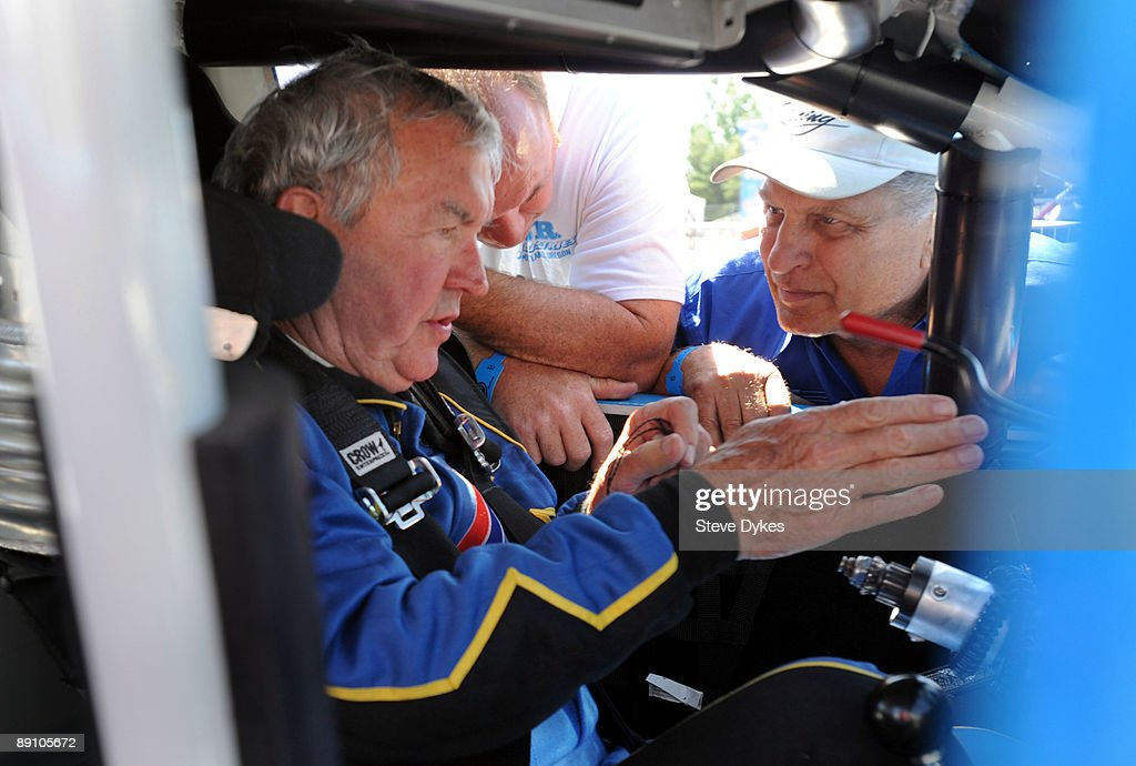 Hershel McGriff (L) speaks with his pit crew after running his qualifying laps for the NASCAR Camping World Series West BI-MART Salute to the Troops 125 at Portland International Raceway on July 19, 2009 in Portland, Oregon.