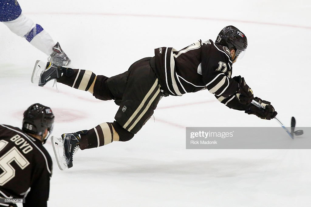 Hershey Bears left wing Chris Bourque (17) is sent airborne and he still gets his shot on net off. Toronto Marlies V Hersey Bears during 2nd period play of Game 5 of AHL playoff action at the Ricoh Coliseum. Hersey leads the series 3-1. Toronto Star/Rick Madonik