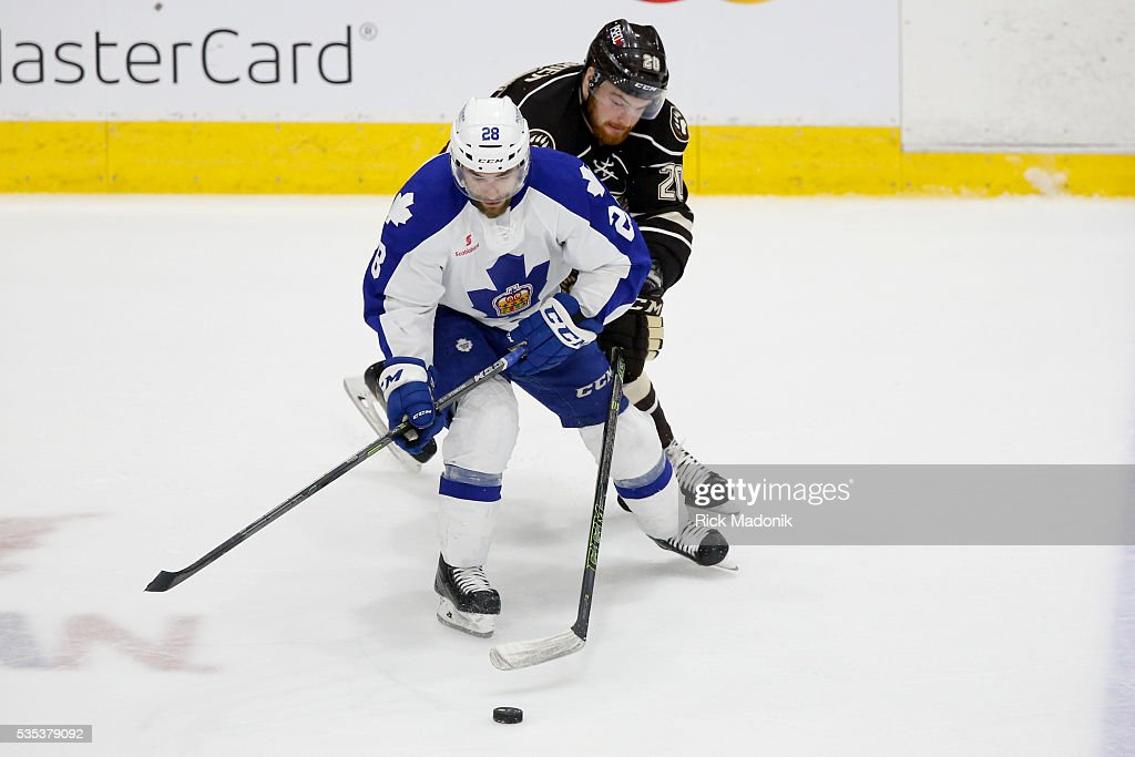 Hershey Bears left wing Liam O'Brien (20) stick checks Toronto Marlies center Mark Arcobello (28) as he moves out of his zone. Toronto Marlies V Hersey Bears during 2nd period play of Game 5 of AHL playoff action at the Ricoh Coliseum. Hersey leads the series 3-1. Toronto Star/Rick Madonik