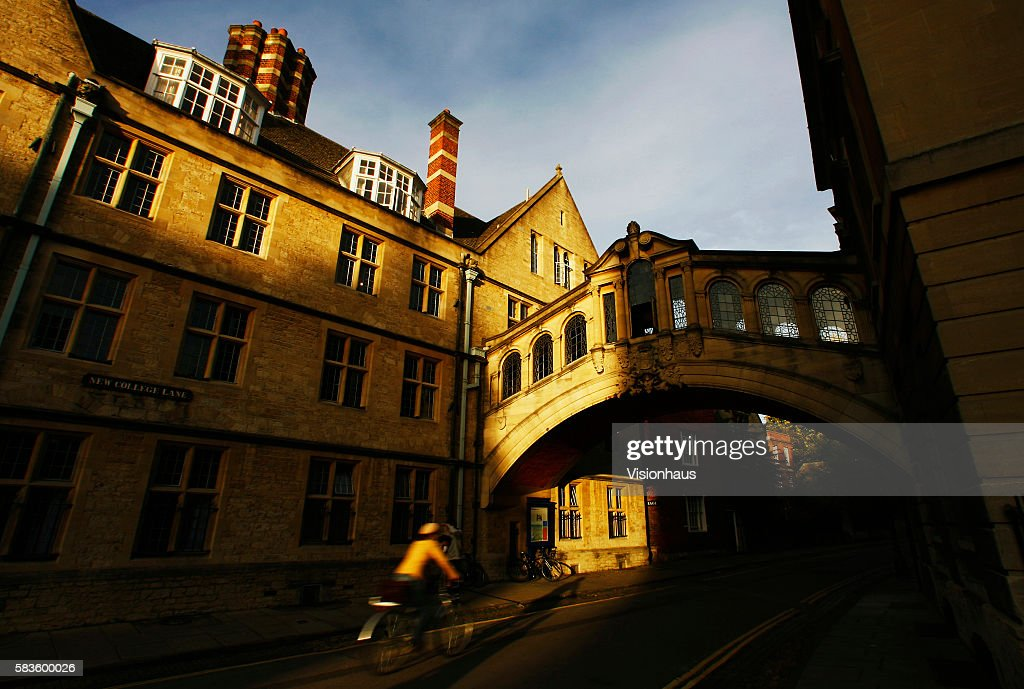 Hertford College's 'Bridge of Sighs' with cyclist casting shadow in the early Autumn sunshine Affectionately named 'the city of dreaming spires' by...