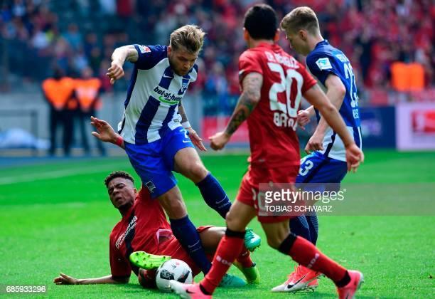 Hertha Berlin's Alexander Esswein and Leverkusen's Benjamin Henrichs vie for vie for the ball during the German first division football match between...