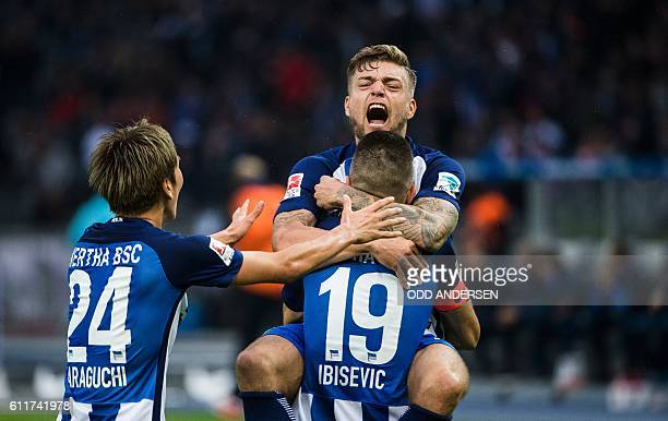 Hertha Berlin's Bosnian forward Vedad Ibisevic celebrate scoring his side's 2nd goal from the penalty spot with his team mates forward Julian...