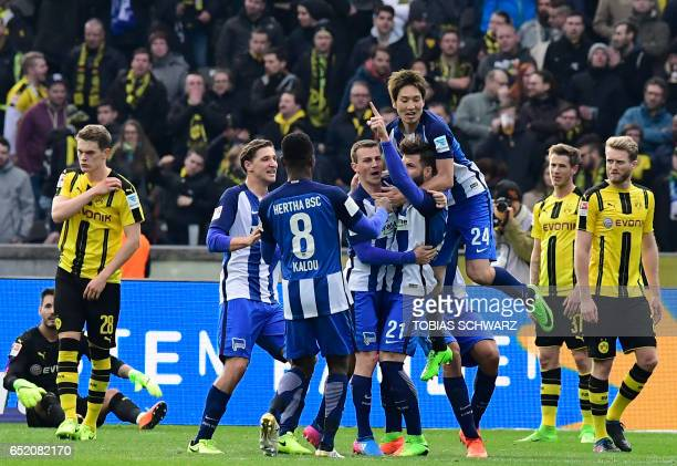 Hertha Berlin's defender Marvin Plattenhardt is congratulated by his teammates after scoring the 21 during the German First division Bundesliga...